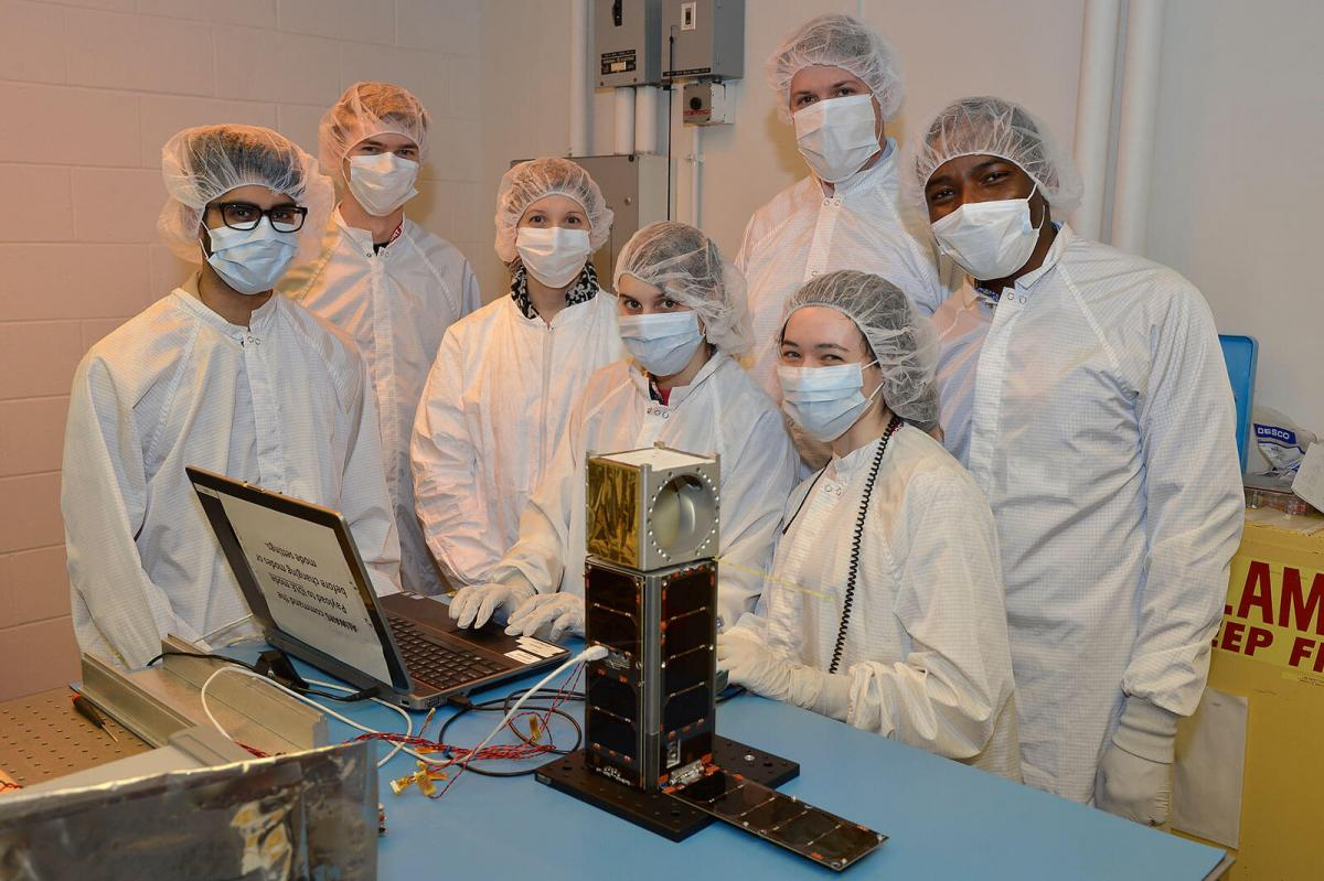 CubeSat and STAR Lab Students In Cleanroom Garb